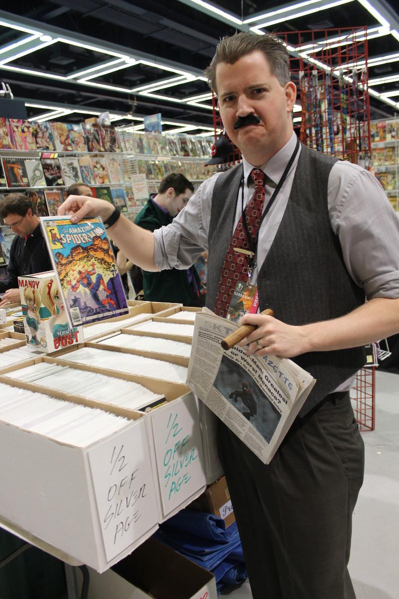 JJJ Holding a Comic